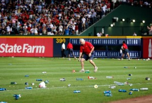 Fans throw trash and debris on field during a 19-minute delay following an infield fly rule call during the 2012 Wild Card game